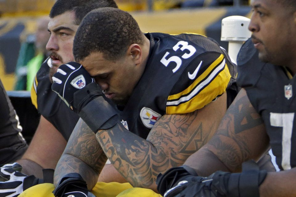 Photo - Pittsburgh Steelers center Maurkice Pouncey (53) sits on the bench during the final minute of the Steelers' 13-10 loss to the Cincinnati Bengals in an NFL football game in Pittsburgh, Sunday, Dec. 23, 2012. (AP Photo/Gene J. Puskar)