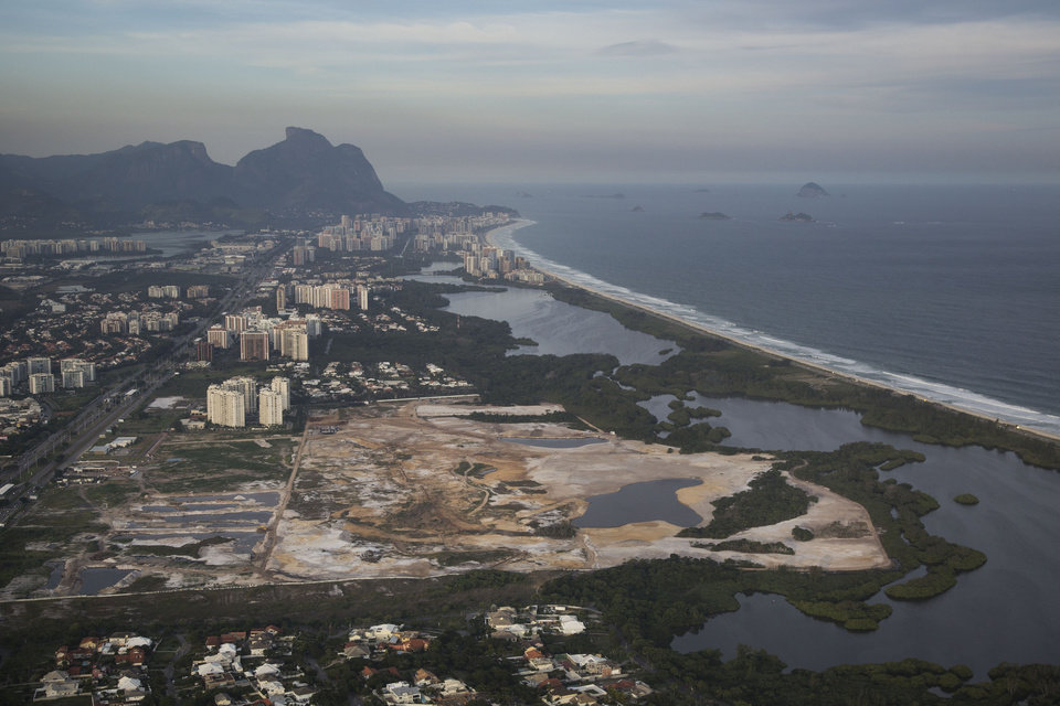 Photo - FILE - This May 13, 2014 file aerial photo, shows the Rio 2016 Olympic golf course under construction in Rio de Janeiro, Brazil. Olympic golf course faces an uncertain future after a court proposed Wednesday, Sept. 3, 2014 that the under-construction layout should be modified to meet environmental concerns. Judge Eduardo Klausner, hearing a lawsuit brought against the city of Rio de Janeiro and the course developer, said the defendants had to return on Sept. 17 to say if they could accept the proposal. Klausner said work on the course could continue, but no new areas of vegetation could be plowed under. (AP Photo/Felipe Dana, File)
