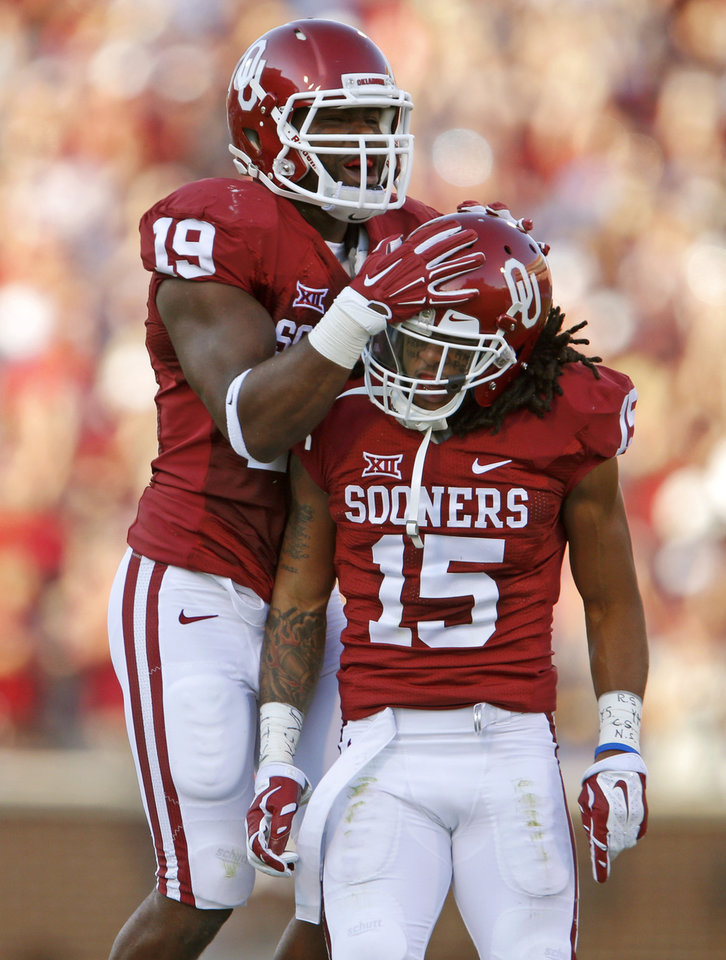 Photo - Oklahoma's Eric Striker (19) and Zack Sanchez (15) celebrate after Sanchez blocked a field goal attempt during a college football game between the University of Oklahoma Sooners (OU) and the Louisiana Tech Bulldogs at Gaylord Family-Oklahoma Memorial Stadium in Norman, Okla., on Saturday, Aug. 30, 2014. Photo by Bryan Terry, The Oklahoman