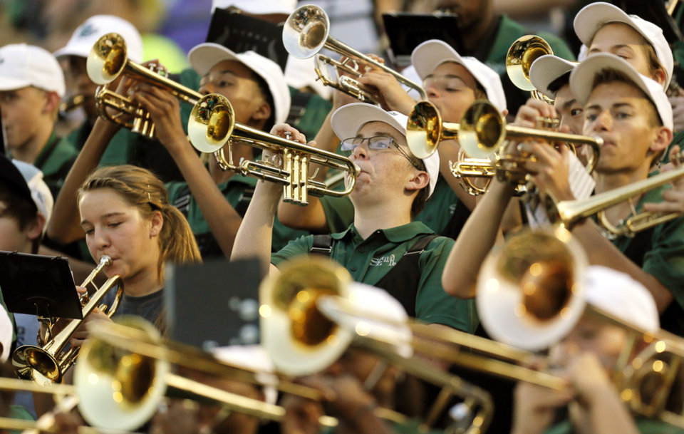 Photo - The Edmond Santa Fe band plays during a high school football game between Edmond Santa Fe and Southmoore at Wantland Stadium in Edmond, Okla., Thursday, Sept. 20, 2012. Photo by Nate Billings, The Oklahoman