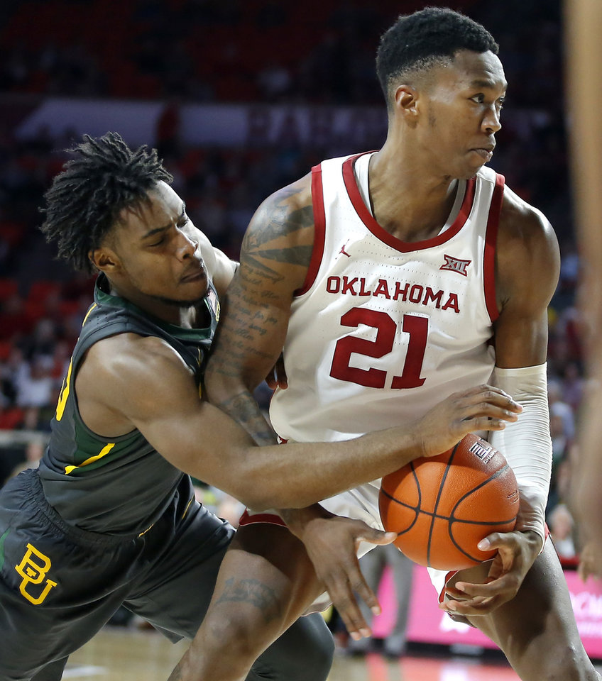 Photo - Baylor's Davion Mitchell (45) tries to knock the ball away from Oklahoma's Kristian Doolittle (21) during a men's NCAA basketball game between the University of Oklahoma Sooners (OU) and the Baylor Bears at the Lloyd Noble Center in Norman, Okla., Tuesday, Feb. 18, 2020. Baylor won 65-54. [Bryan Terry/The Oklahoman]