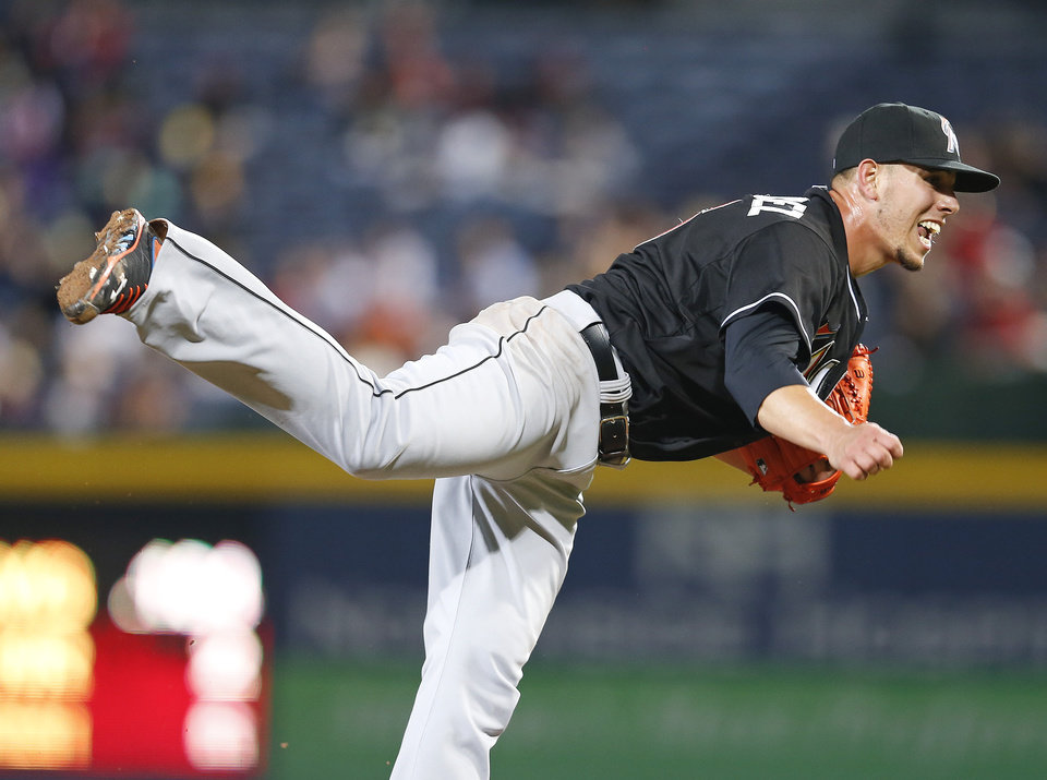 Photo - Miami Marlins starting pitcher Jose Fernandez (16) works in the sixth inning of a baseball game against Atlanta Braves Tuesday, April 22, 2014 in Atlanta.  (AP Photo/John Bazemore)