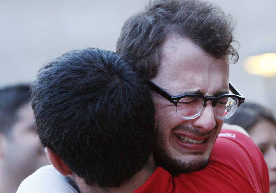 Photo -   Boston University student Blake Wrobbel, of Los Angeles, right, gets emotional during a candlelight vigil on Marsh Plaza at Boston University, Saturday, May 12, 2012, for three students studying in New Zealand who were killed when their minivan crashed during a weekend trip. Daniela Lekhno, 20, of Manalapan, N.J.; Austin Brashears, 21, of Huntington Beach, Calif.; and Roch Jauberty, 21, whose parents live in Paris, were killed as they travel in a minivan at about 7:30 a.m. Saturday near the North Island vacation town of Taupo when the vehicle drifted to the side of the road and then rolled when the driver tried to correct course. (AP Photo/Bizuayehu Tesfaye)