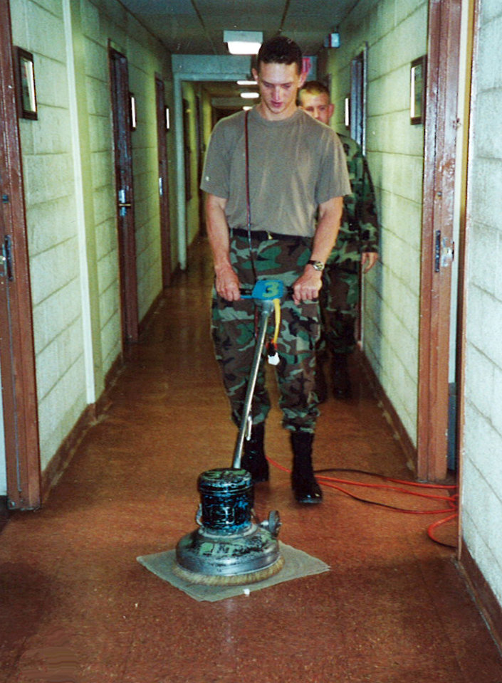 Photo - In this July 2000 image provided by Sean McGuire, Israel Keyes is seen buffing a floor during his military days in Fort Lewis, Wash.  Keyes showed no remorse as he detailed how he'd abducted and killed the 18-year-old woman, then demanded ransom, pretending she was alive. His confession cracked the case, but prosecutors questioning him soon realized there was more, he has killed before.  Before divulging more details, Keyes committed suicide in his cell.  (AP Photo/Sean McGuire)