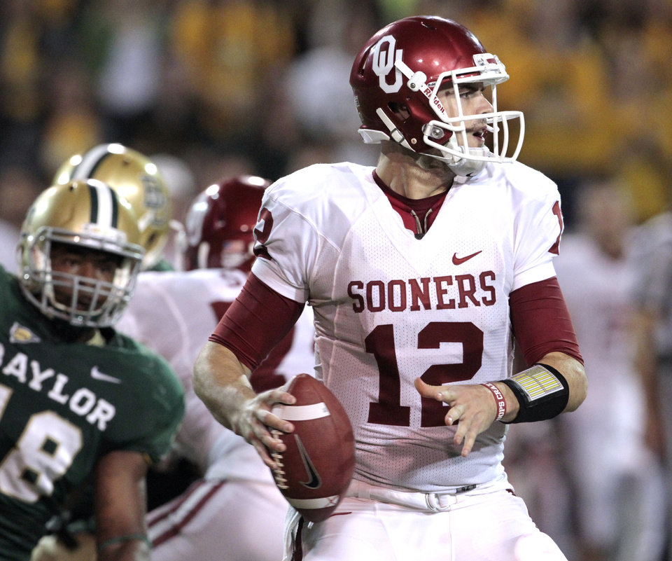 Oklahoma's Landry Jones (12) looks to pass during the second half of the college football game in which the University of Oklahoma Sooners (OU) was defeated 45-38 by the Baylor Bears (BU) at Floyd Casey Stadium on Saturday, Nov. 19, 2011, in Waco, Texas.   Photo by Steve Sisney, The Oklahoman ORG XMIT: KOD