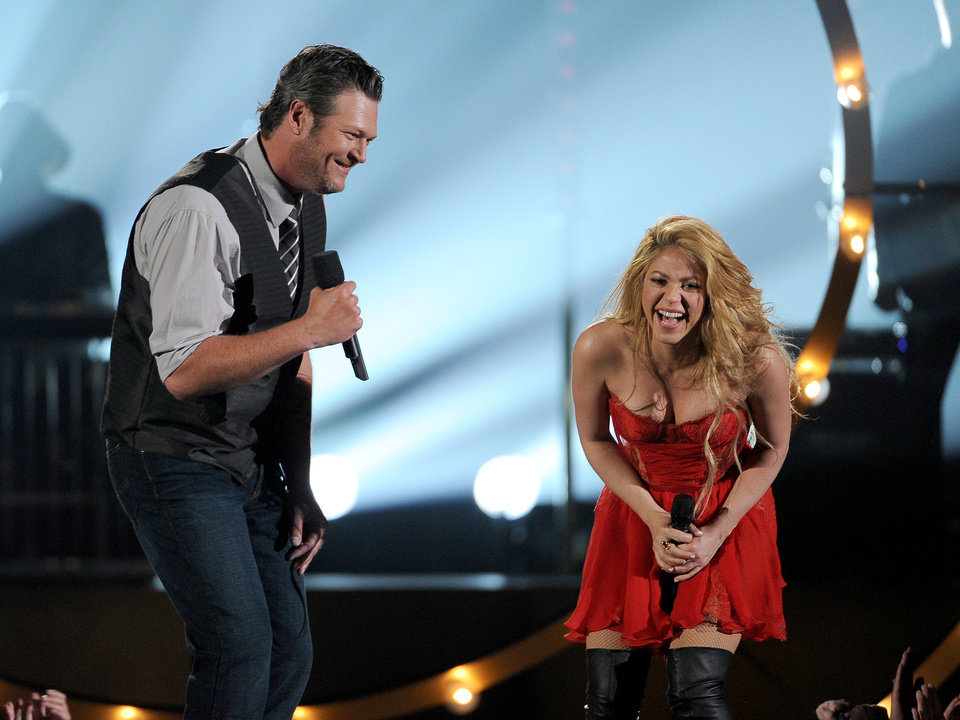 Photo - Blake Shelton, left, and Shakira perform on stage at the 49th annual Academy of Country Music Awards at the MGM Grand Garden Arena on Sunday, April 6, 2014, in Las Vegas. (Photo by Chris Pizzello/Invision/AP)