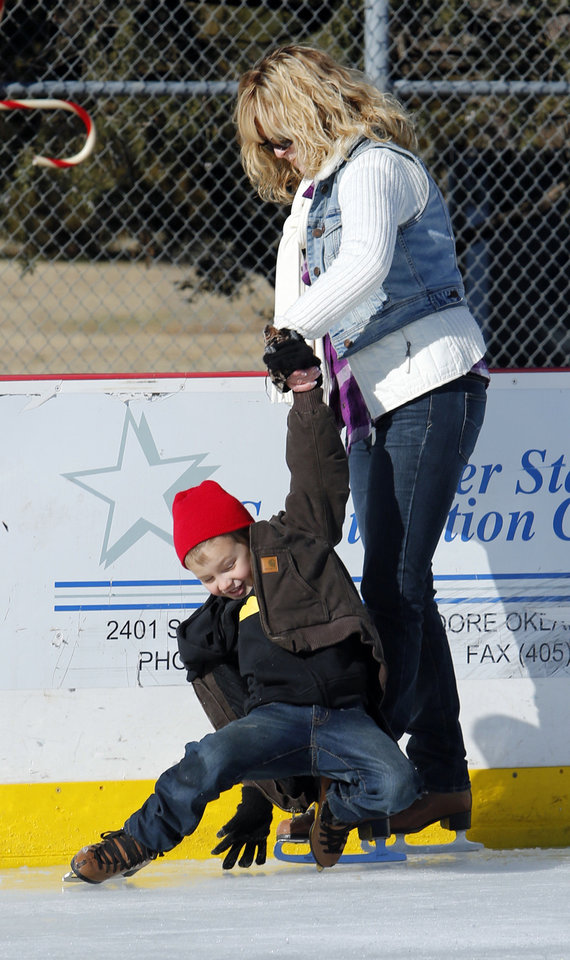 Photo - Weston Setzer, 5, gets assistance from his grandmother Rhonda Zimmer as they skate at the outdoor rink at Andrews Park in Norman. PHOTO BY STEVE SISNEY, THE OKLAHOMAN  STEVE SISNEY