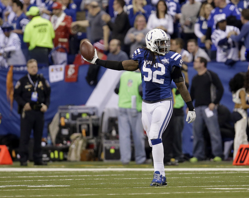 Photo - Indianapolis Colts' Kelvin Sheppard (52) holds up the football after recovering a fumble against the Kansas City Chiefs during the second half of an NFL wild-card playoff football game Saturday, Jan. 4, 2014, in Indianapolis. (AP Photo/AJ Mast)