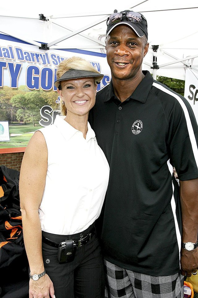 Photo - Darryl Strawberry started to turn his life around when he met his wife Tracy, left. AP photo