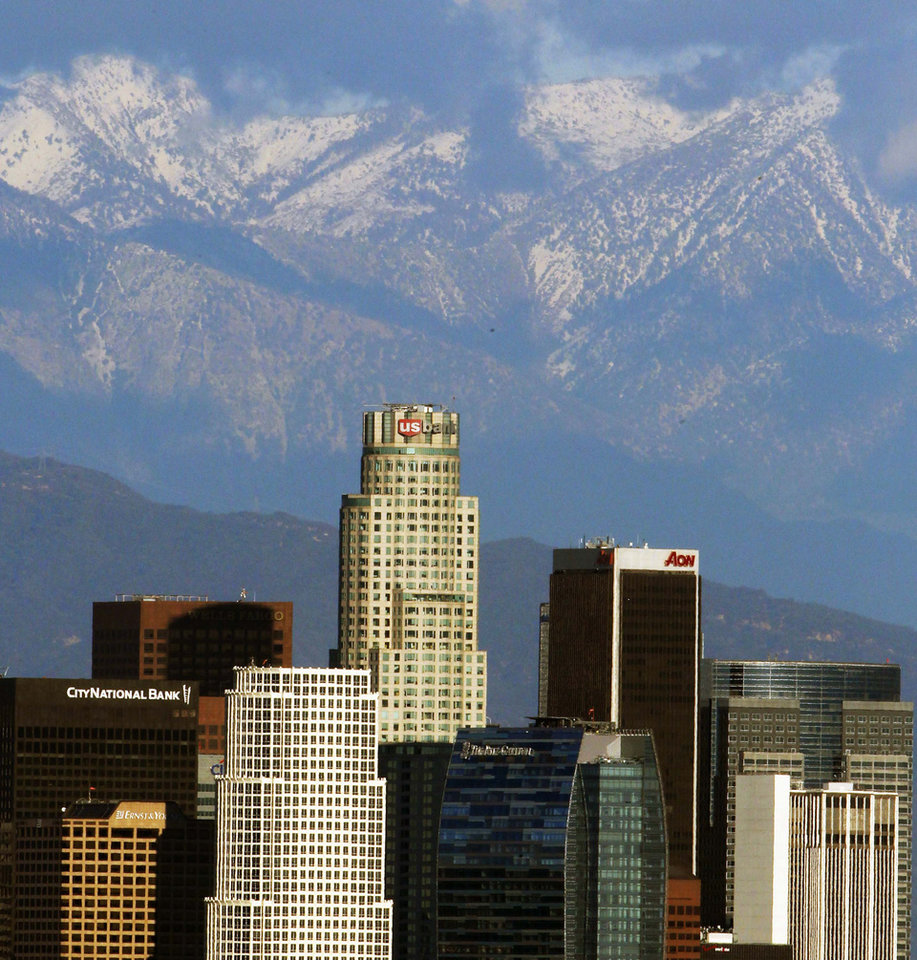 Snow covered San Gabriel Mountains is seen behind the downtown Los Angeles skyline Thursday, Dec 27, 2012. (AP Photo/Nick Ut)