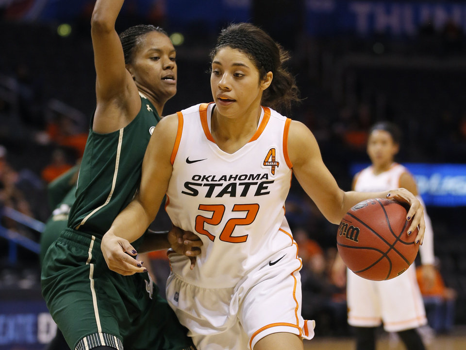 Oklahoma State's Brittney Martin (22) goes around South Florida's Courtney Williams (10) during the All-College Classic women's basketball game between Oklahoma State University and South Florida at Chesapeake Energy Arena in Oklahoma City, Okla., Saturday, Dec. 14, 2013. Photo by Bryan Terry, The Oklahoman