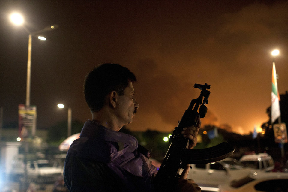 Photo - A Pakistani soldier takes position at Jinnah International Airport  where security forces are fighting with gunmen who disguised themselves as police guards and stormed a terminal used for VIPs and cargo, Sunday night, June 8, 2014, in Pakistan. The airport attack still was ongoing early Monday in Karachi, a sprawling port city on the southern coast of Pakistan, although officials said all the passengers had been evacuated.  (AP Photo/Shakil Adil)