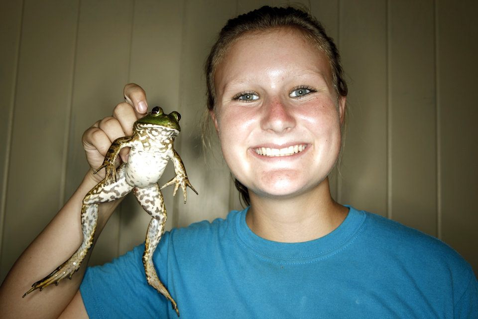 Photo - Kasey Mengwasser, 14, poses with a bullfrog after the frog and turtle races, Wednesday, June 24, 2009, at  Camp DaKaNi in Oklahoma City. Photo by Sarah Phipps, The Oklahoman ORG XMIT: KOD