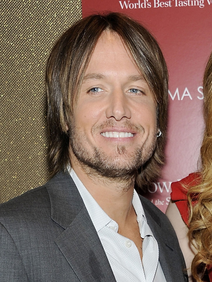 "Photo -  FILE - In this July 13, 2011 file photo, country singer Keith Urban attends a special screening of ""Snow Flower and the Secret Fan"" in New York. Urban will perform at the Grand Ole Opry on Feb. 3.  It is his first public performance since undergoing vocal surgery. (AP Photo/Evan Agostini, file) ORG XMIT: NYET723"