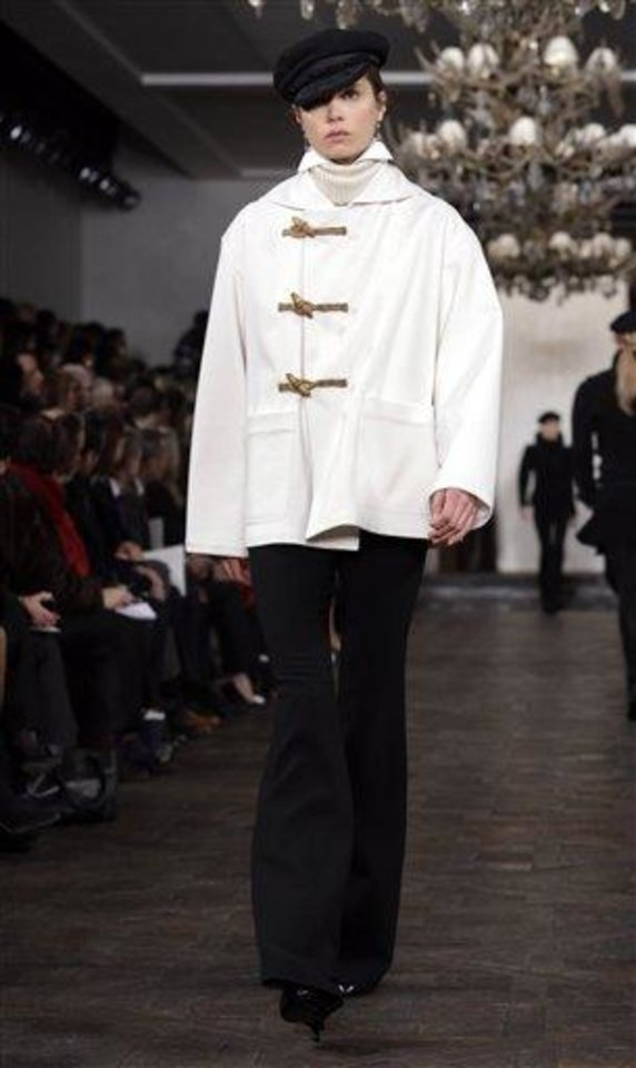 Photo - The Ralph Lauren Fall 2013 collection is modeled during Fashion Week in New York,  Thursday, Feb. 14, 2013. (AP Photo/Richard Drew)