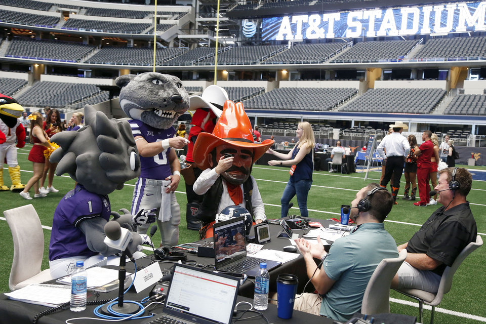 Photo - Mascots with radio media at the Big 12 Media Day at AT&T Stadium in Dallas, TX, July 15, 2019. STEPHEN PINGRY/Tulsa World