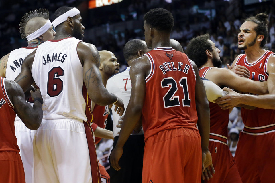 Photo - Chicago Bulls center Joakim Noah, far right, yells out after he and Miami Heat forward LeBron James (6) received technical fouls during the first half of Game 2 of their NBA basketball playoff series in the Eastern Conference semifinals, Wednesday, May 8, 2013, in Miami. (AP Photo/Lynne Sladky)