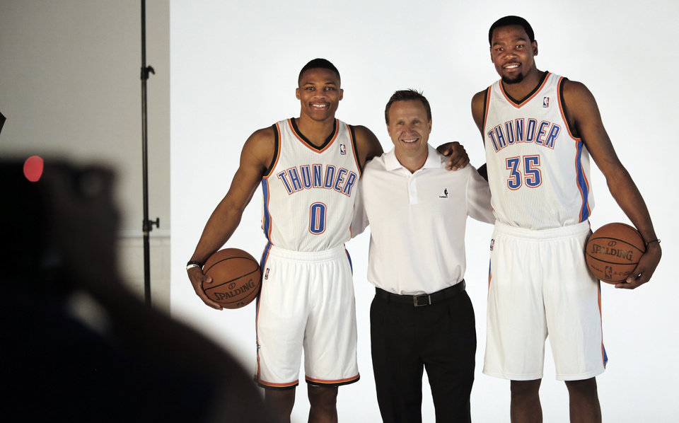Photo - Russell Westbrook, coach Scott Brooks and Kevin Durant pose for photos during media day with the Oklahoma City Thunder in Oklahoma City, Thursday September  27, 2013. Photo By Steve Gooch, The Oklahoman