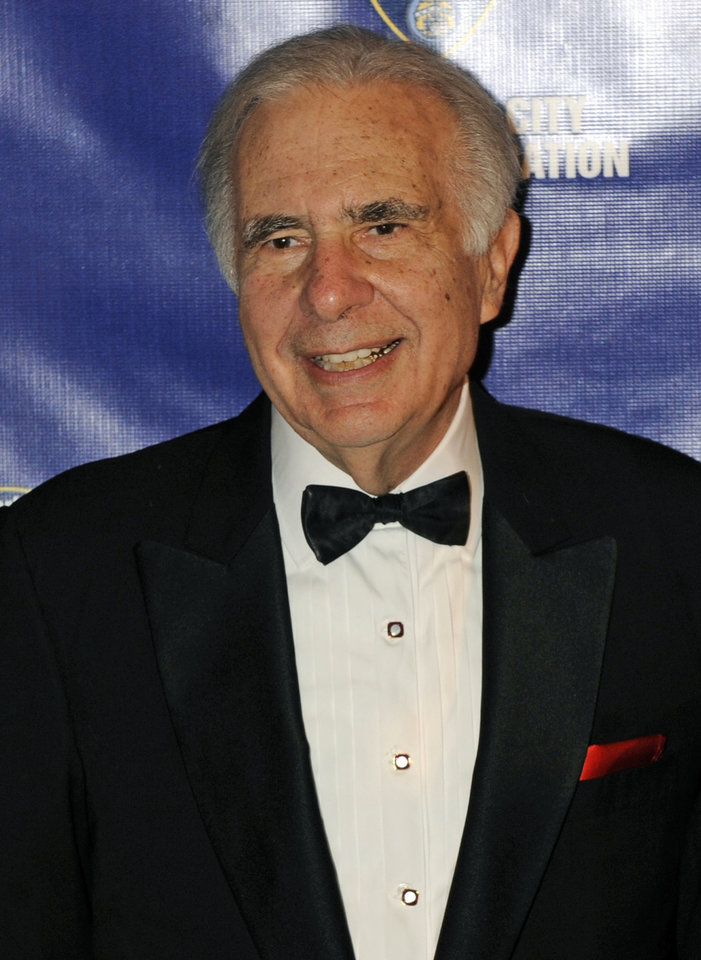 FILE - In this March 16, 2010 file photo, financier Carl Icahn poses for photos upon arriving for the 32nd annual New York City Police Foundation Gala in New York. In a Wednesday, Oct. 31, 2012 regulatory filing, Icahn revealed he had used some of his $14 billion fortune to accumulate a 10 percent stake in Netflix Inc. (AP Photo/Henny Ray Abrams, File) ORG XMIT: NY125