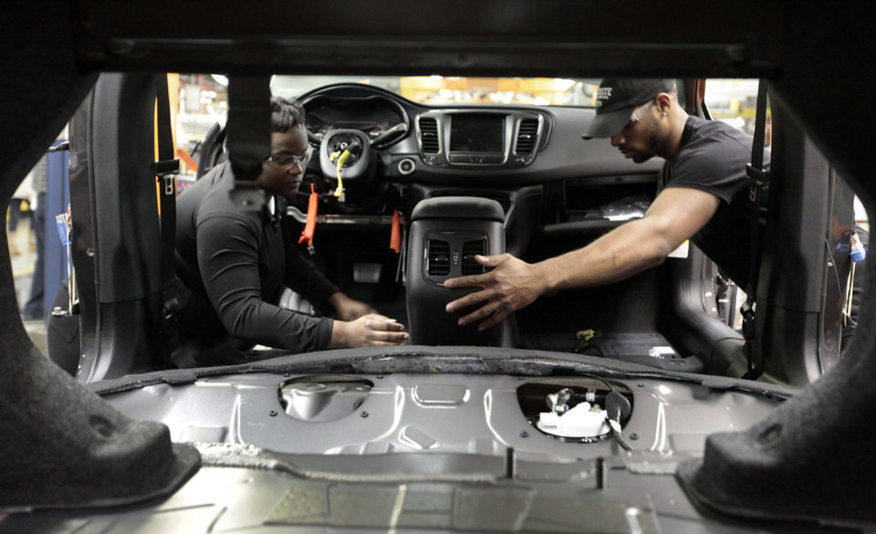Assembly line workers build a 2015 Chrysler 200 automobile at the Sterling Heights Assembly Plant in Sterling Heights, Mich.  AP Photo  <strong>Paul Sancya -  AP </strong>