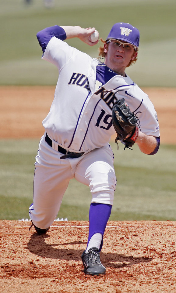 Photo - Washington pitcher Tyler Davis pitches against Georgia Tech in the third inning of an NCAA college baseball regional tournament game in Oxford, Miss., Saturday, May 31, 2014. (AP Photo/Rogelio V. Solis)