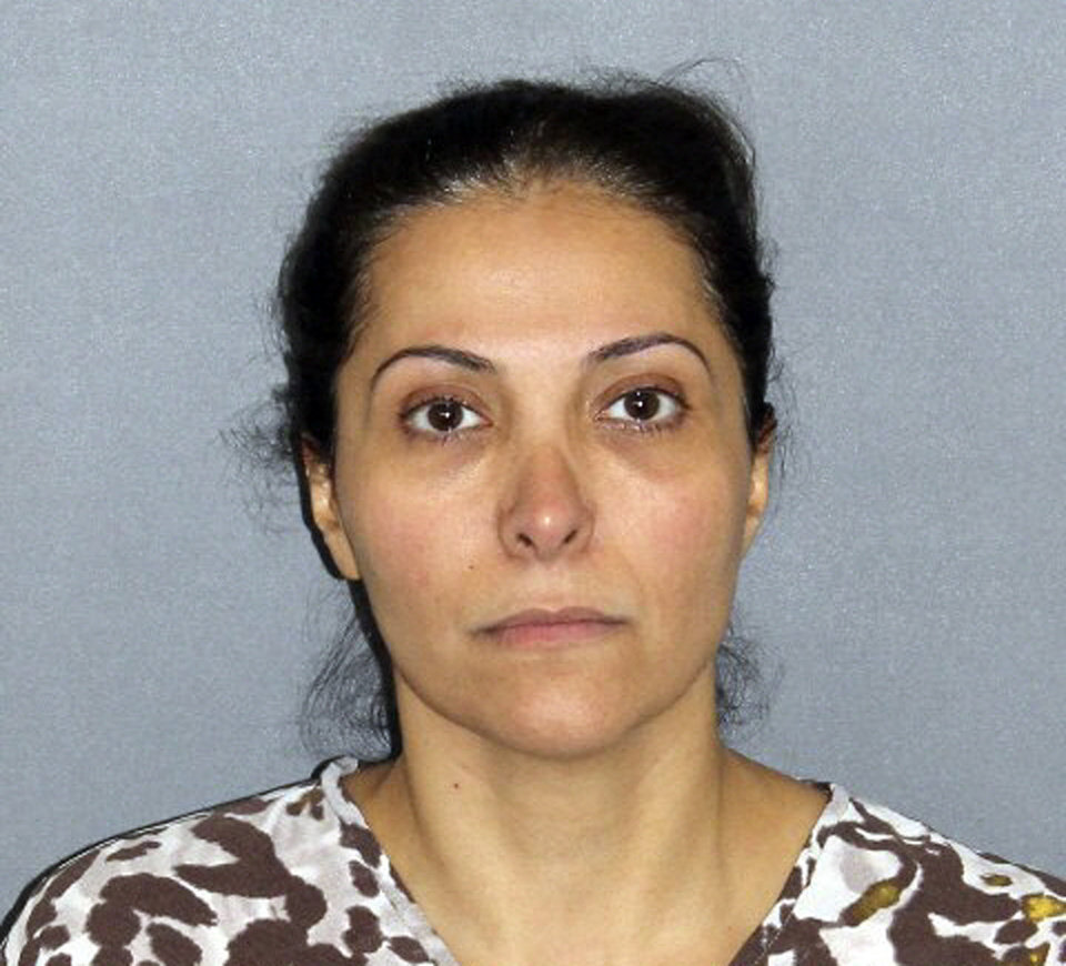 Photo - FILE - This file photo provided by the Irvine Police Department shows Meshael Alayban, who was arrested July 9, 2013 in Irvine, Calif., for allegedly holding a domestic servant against her will. Alayban, who prosecutors said is one of the wives of Saudi Prince Abdulrahman bin Nasser bin Abdulaziz al Saud, was expected to appear in an Orange County court for arraignment Thursday, July 11, 2013. (AP Photo/Irvine Police Department, File)