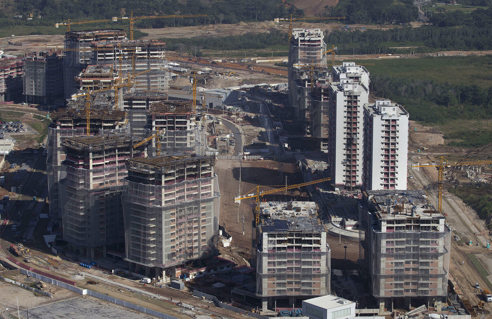 Photo - This June 27, 2014 photo shows the Athletes Village under construction ahead of the Rio 2016 Olympic and Paralympic Games, in Rio de Janeiro, Brazil. A few months ago International Olympic Committee vice president John Coates called the city's preparations the