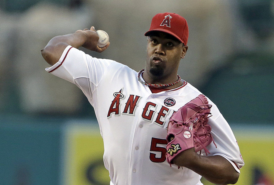 Photo - Los Angeles Angels starter Jerome Williams pitches to the Seattle Mariners in the first inning of a baseball game in Anaheim, Calif., Saturday, Sept. 21, 2013. (AP Photo/Reed Saxon)