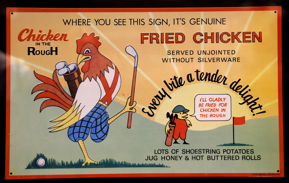 Photo -  A framed sign featuring Beverly's logo and the restaurant's most famous dish, Chicken in the Rough, hangs on a wall beside a booth.  Photos by Jim Beckel, The Oklahoman   Jim Beckel -  THE OKLAHOMAN