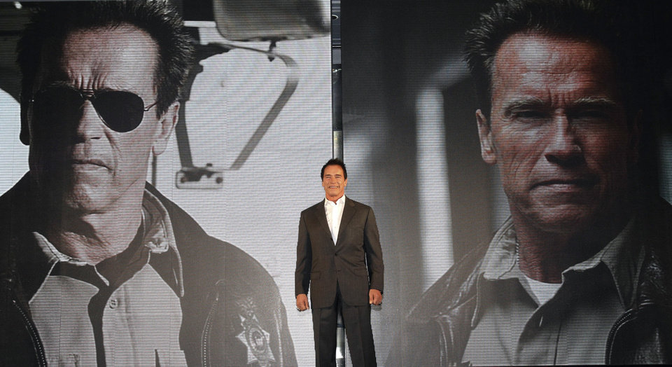Photo - Actor Arnold Schwarzenegger poses during a press conference to promote his latest film