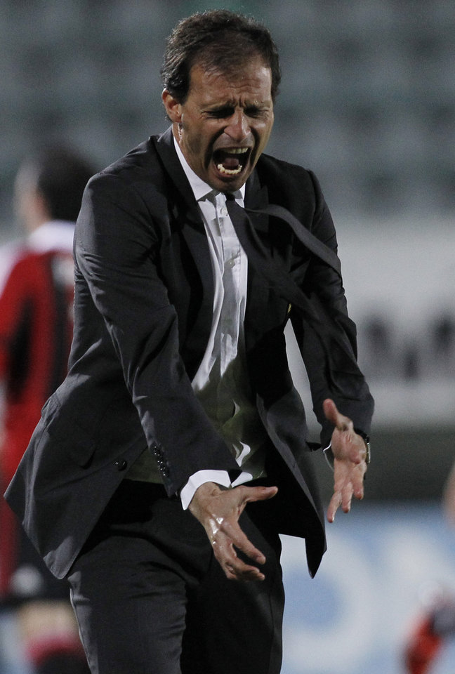 AC Milan coach Massimiliano Allegri shouts during a Serie A soccer match between Siena and AC Milan, in Siena, Italy, Sunday, May 19, 2013. (AP Photo/Paolo Lazzeroni)