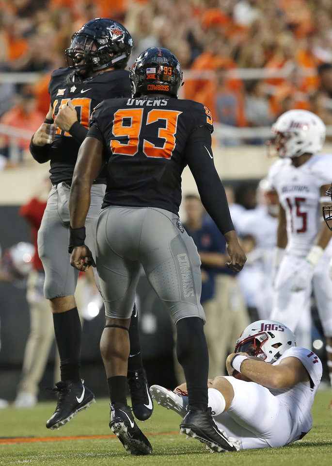 Photo - Oklahoma State's Brock Martin (40) celebrates a sack of South Alabama's Evan Orth (14) as Jarrell Owens (93) looks on during a college football game between Oklahoma State (OSU) and South Alabama at Boone Pickens Stadium in Stillwater, Okla., Saturday, Sept. 8, 2018. Photo by Sarah Phipps, The Oklahoman