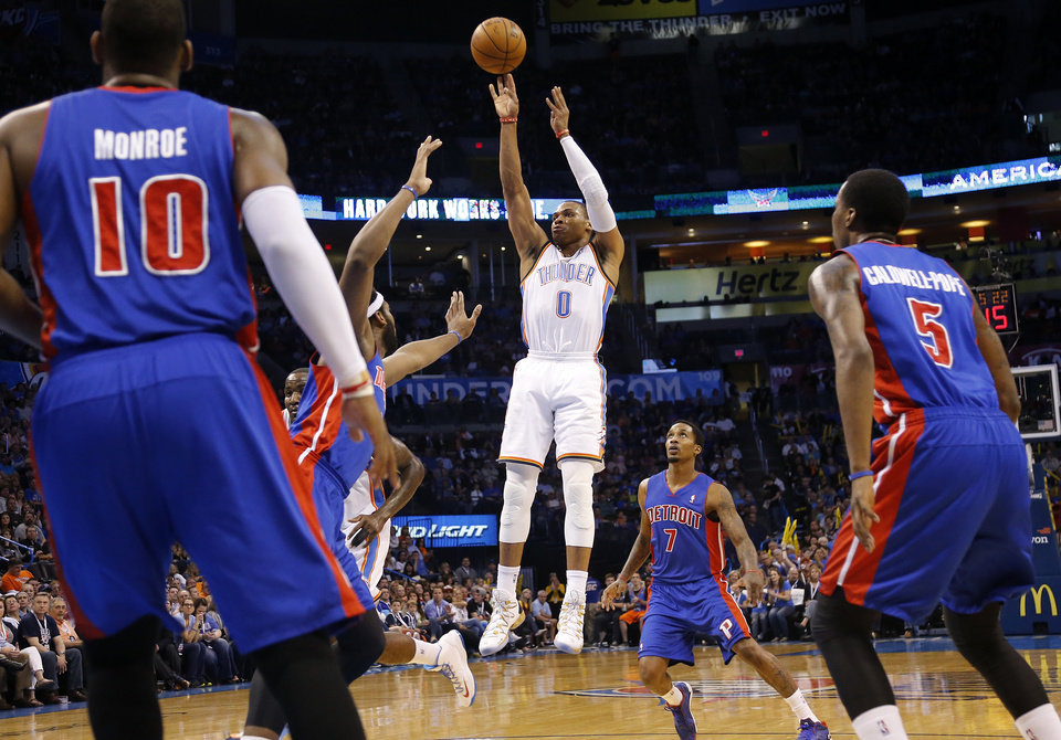 Photo - Oklahoma City's Russell Westbrook (0) shoots over the Detroit defense during the NBA basketball game between the Oklahoma City Thuder and the Detroit Pistons at Chesapeake Energy Arena in Oklahoma City, Okla. on Wednesday, April 16, 2014.  Photo by Chris Landsberger, The Oklahoman