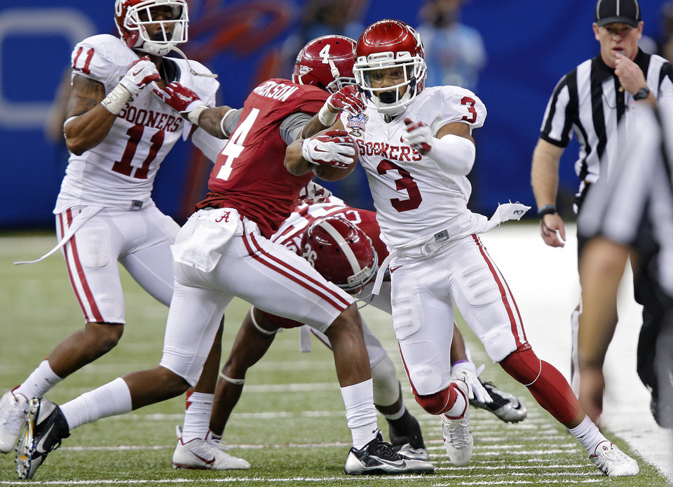 Photo - Oklahoma's Sterling Shepard (3) goes down the sideline past Alabama's Eddie Jackson (4) during the NCAA football BCS Sugar Bowl game between the University of Oklahoma Sooners (OU) and the University of Alabama Crimson Tide (UA) at the Superdome in New Orleans, La., Thursday, Jan. 2, 2014.  .Photo by Chris Landsberger, The Oklahoman