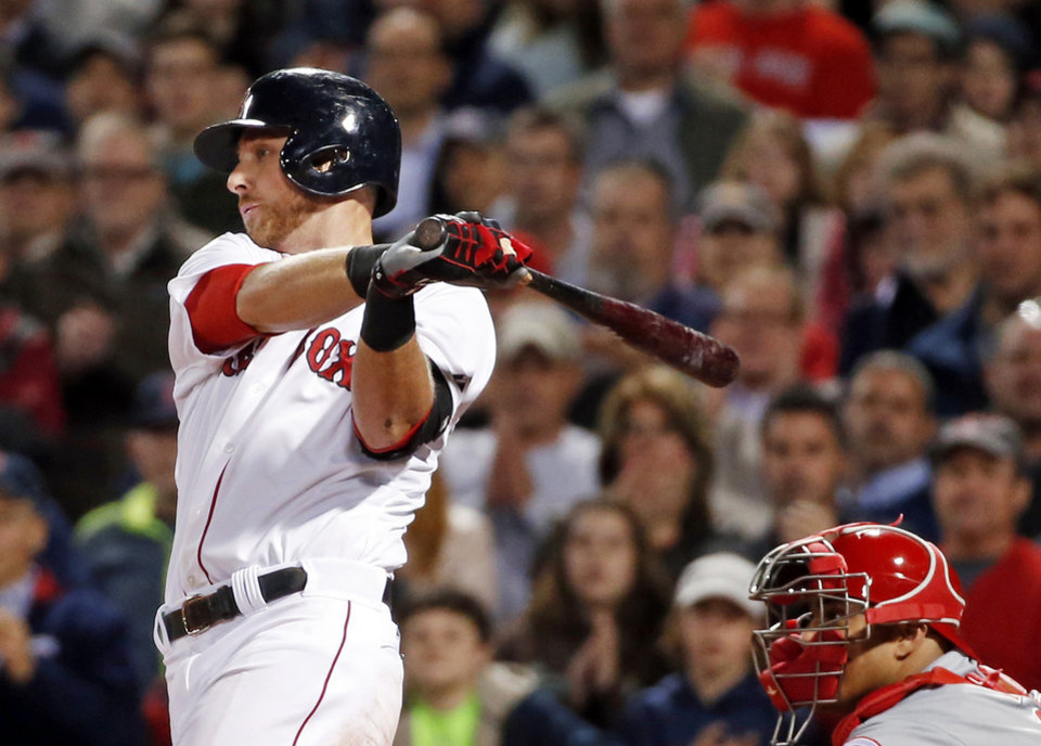 Photo - Boston Red Sox's Will Middlebrooks hits an RBI single as Cincinnati Reds catcher Brayan Pena is behind the plate in the eighth inning of a baseball game at Fenway Park in Boston, Wednesday, May 7, 2014. (AP Photo/Elise Amendola)