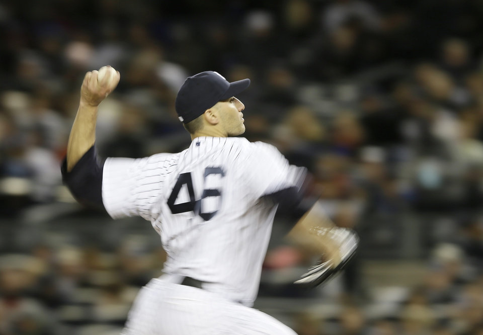 New York Yankees\' Andy Pettitte throws in the second inning during Game 1 of the American League championship series against the Detroit Tigers Saturday, Oct. 13, 2012, in New York. (AP Photo/Matt Slocum)