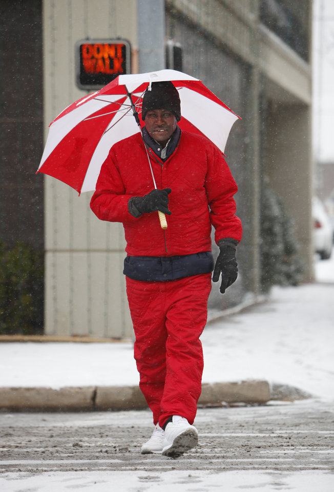 Snow art. Earl Rushing walks to the library for a class, Friday, December 28, 2012.  Photo By David McDaniel/The Oklahoman