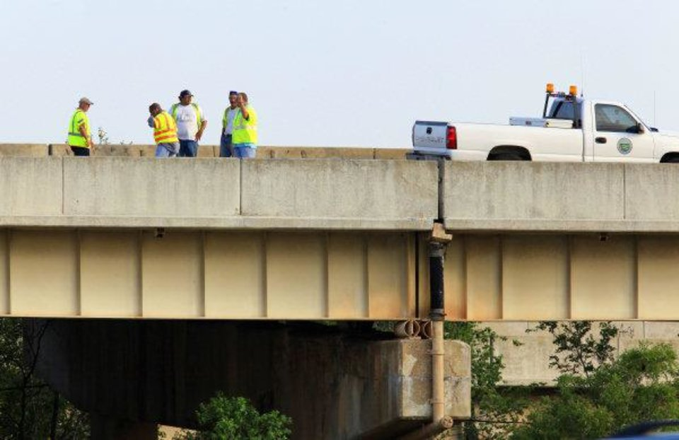 Oklahoma Department of Transportation workers and vehicle are shown in the far left eastbound lane of Interstate 44 on the Belle Isle bridge where it crosses over the Northwest Expressway in Oklahoma City on Monday. Two eastbound lanes were closed when an expansion joint, shown just right of the center in the photo, failed, causing damage to vehicles traveling on the highway. Photo by Paul B. Southerland, The Oklahoman PAUL B. SOUTHERLAND