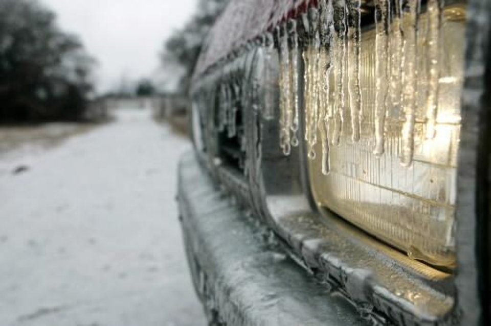 Photo - A head light is covered with ice in Logan County , Okla. Dec. 09, 2007. BY STEVE GOOCH