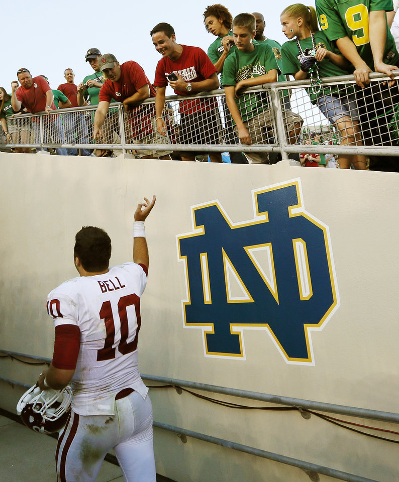Photo - Oklahoma's Blake Bell (10) points to OU fans as he leaves the field after a college football game between the University of Oklahoma Sooners and the Notre Dame Fighting Irish at Notre Dame Stadium in South Bend, Ind., Saturday, Sept. 28, 2013. OU won, 35-21. Photo by Nate Billings, The Oklahoman