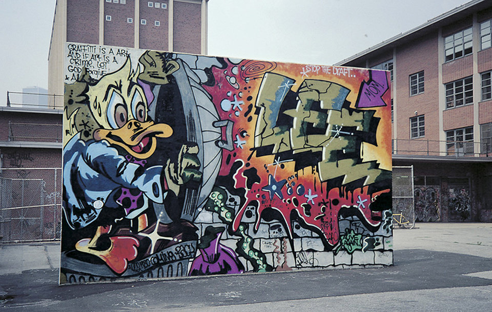 """Photo - In this 1978 photo provided by the Museum of the City of New York, the graffiti mural """"Howard the Duck,"""" is painted on a handball court in New York.  The Lee Quinones mural was a pivotal work that helped propel the illicit graffiti art movement from the subway system to above ground, and into the mainstream. The original mural has been painted over, but Quinones recreated it on canvas and it is part of the exhibition,"""