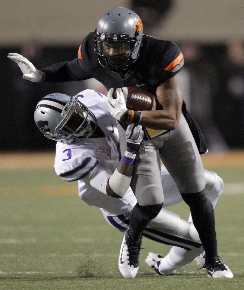 Photo - Oklahoma State's Michael Harrison (7) is tackled by Kansas State's Allen Chapman (3) during a college football game between the Oklahoma State University Cowboys (OSU) and the Kansas State University Wildcats (KSU) at Boone Pickens Stadium in Stillwater, Okla., Saturday, Nov. 5, 2011.  Photo by Sarah Phipps, The Oklahoman