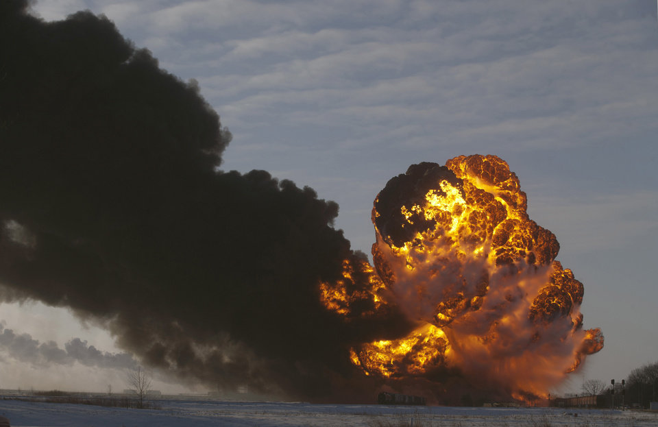 "FILE - In this Dec. 30, 2013 file photo, a fireball goes up at the site of an oil train derailment in Casselton, N.D. Warning that a ""major loss of life"" could result from an accident involving the increasing use of trains to transport large amounts of crude oil, U.S. and Canadian accident investigators urged their governments to take a series of safety measures. The oil train derailed and exploded near Casselton, N.D., creating intense fires. The accident occurred about a mile outside the town, and no one was hurt. Rail lines run through and alongside the town. (AP Photo/Bruce Crummy, File)"