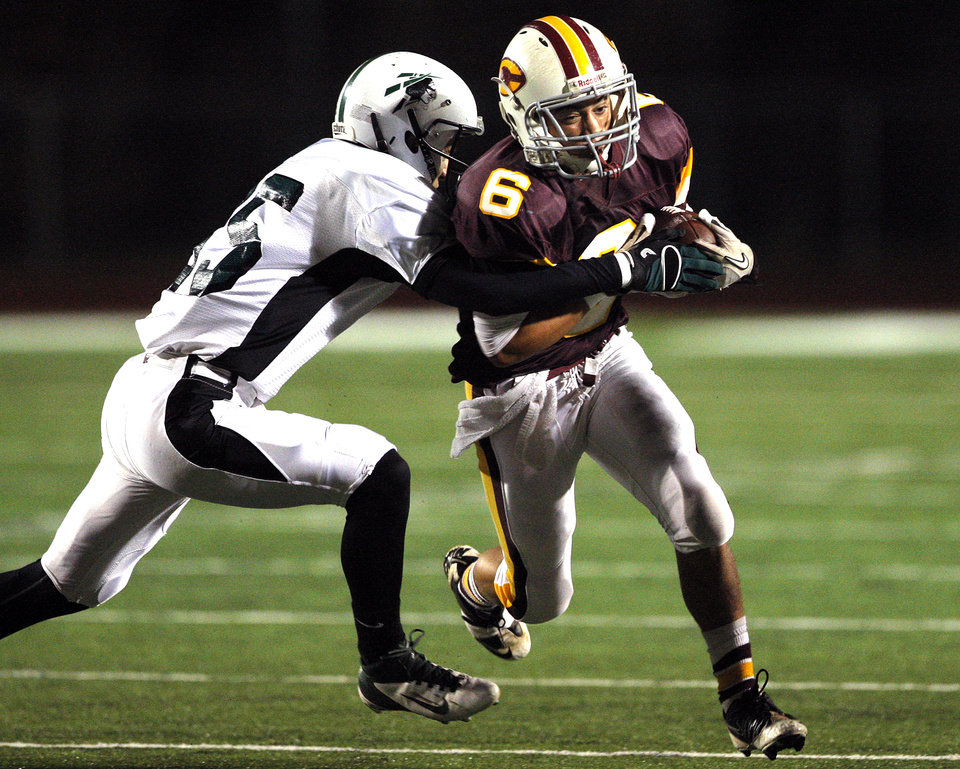 Photo - Clinton's Devon Mitchell gets by a Catoosa defender during the high school playoff game between Clinton and Catoosa at Putnam City High School.,  Friday, Nov. 25, 2011.  Photo by Sarah Phipps, The Oklahoman