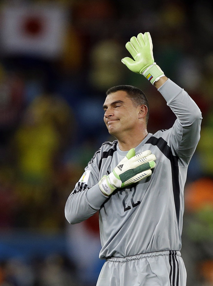 Photo - Colombia's goalkeeper Faryd Mondragon, waves to spectators after the group C World Cup soccer match between Japan and Colombia at the Arena Pantanal in Cuiaba, Brazil, Tuesday, June 24, 2014. Colombia won the match 4-1. (AP Photo/Kirsty Wigglesworth)