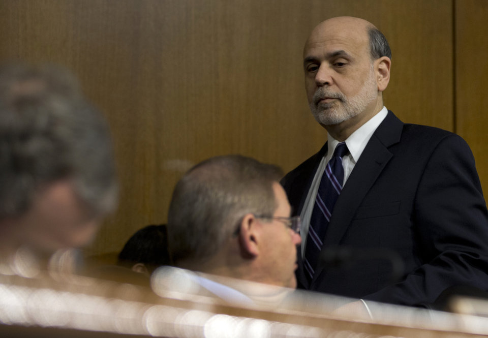 Federal Reserve Board Chairman Ben Bernanke arrives on Capitol Hill in Washington, Tuesday, Feb. 26, 2013, to testify before the Senate Banking Committee hearing to deliver the central bank's Semiannual Monetary Policy Report to the Congress. (AP Photo/Carolyn Kaster)