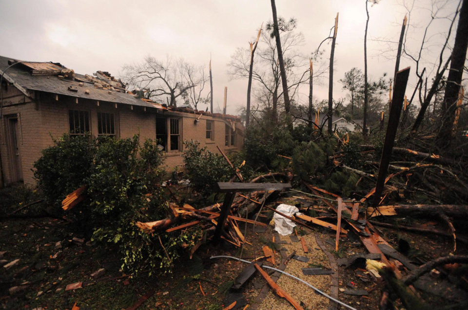 A house was damaged in Hattiesburg Miss., after a tornado passed through the city Sunday, Feb. 10, 2013. AP photo <strong>Ryan Moore</strong>