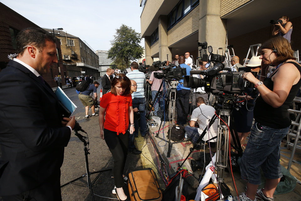 Photo - Members of the broadcast media give live reports across from St. Mary's Hospital exclusive Lindo Wing in London, Monday, July 22, 2013. Buckingham Palace officials say Prince William's wife, Kate, has been admitted to the hospital in the early stages of labour.Royal officials said that Kate traveled by car to St. Mary's Hospital in central London. Kate _ also known as the Duchess of Cambridge _ is expected to give birth in the private Lindo Wing of the hospital, where Princess Diana gave birth to William and his younger brother, Prince Harry.The baby will be third in line for the British throne _ behind Prince Charles and William _ and is anticipated eventually to become king or queen. (AP Photo/Lefteris Pitarakis)