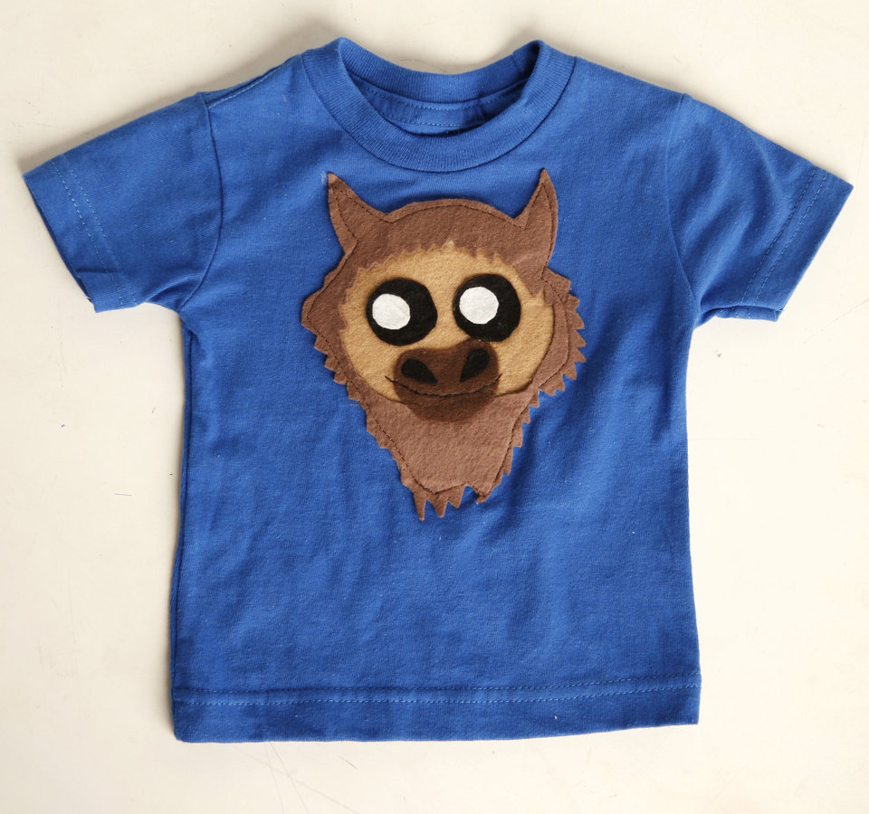 Kid\'s blue Rumble T-shirt sold at DNA Galleries. Photo by Doug Hoke, The Oklahoman DOUG HOKE