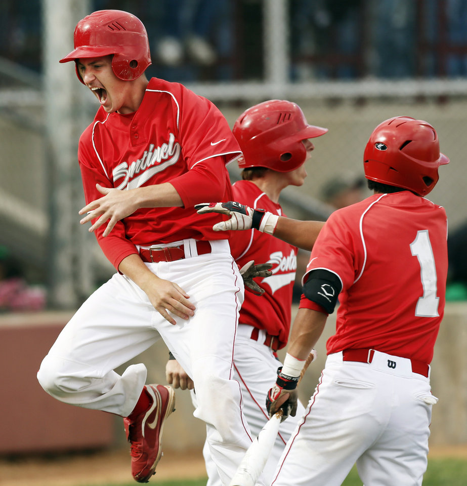 Photo - Sentinel's Seth Housley (2) celebrates with teammates Brock Carter (5) and David Martinez (1) after Housley and Carter scored in the first inning during a Class B high school baseball game between between Leedey and Sentinel in the state baseball tournament at the Edmond Memorial baseball field in Edmond, Okla., Friday, May 3, 2013. Photo by Nate Billings, The Oklahoman